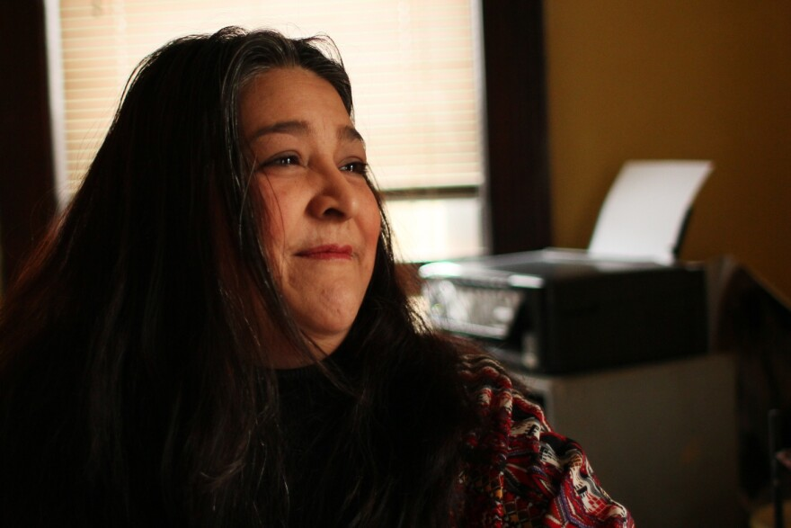 Elizabeth Vega reflects on the art created in her her home, called Art House, in this February 6, 2017 photo.
