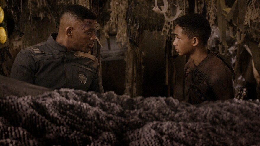 Will Smith (left) and Jaden Smith star in <em>After Earth, </em>an unfortunately humorless film.