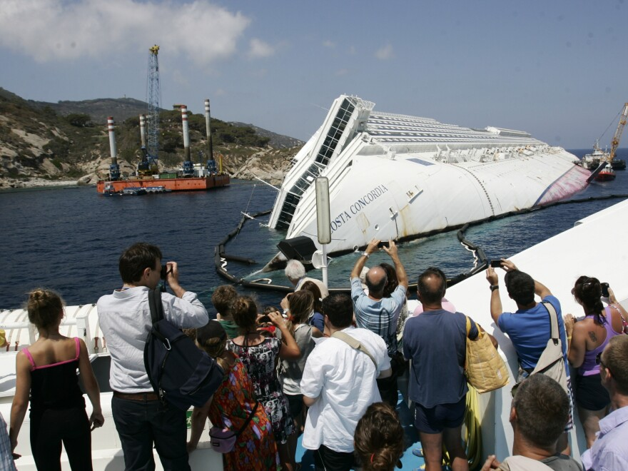 Giglio Island's nature-loving tourists have been replaced by day-trippers who want a look at the massive wreck of the Costa Concordia.