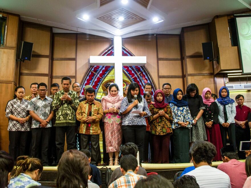 Indonesians from different religious groups take part in a joint prayer for the victims of a bomb attack on a church in Surabaya earlier this month.