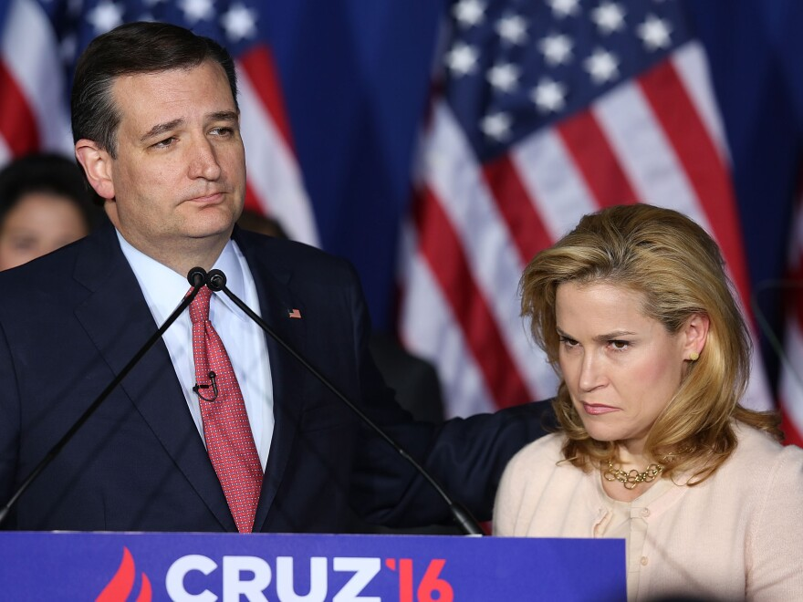 Sen. Ted Cruz, R-Texas, suspends his presidential campaign as his wife, Heidi, looks on Tuesday night in Indianapolis, Ind.
