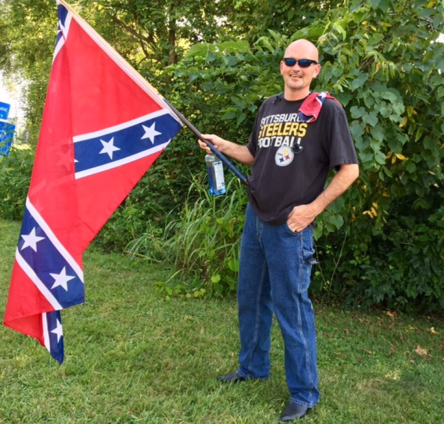 More than a dozen people waved Confederate flags and called for the return of a Confederate monument to its historic location on Dixie Highway in the Warren County city of Franklin.