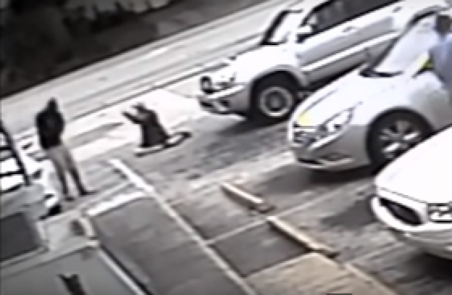 This screenshot of a video, posted to YouTube, shows Michael Drejka (right) in the moment before he shot Markeis McGlockton in the parking lot of a Pinellas County convenient store.