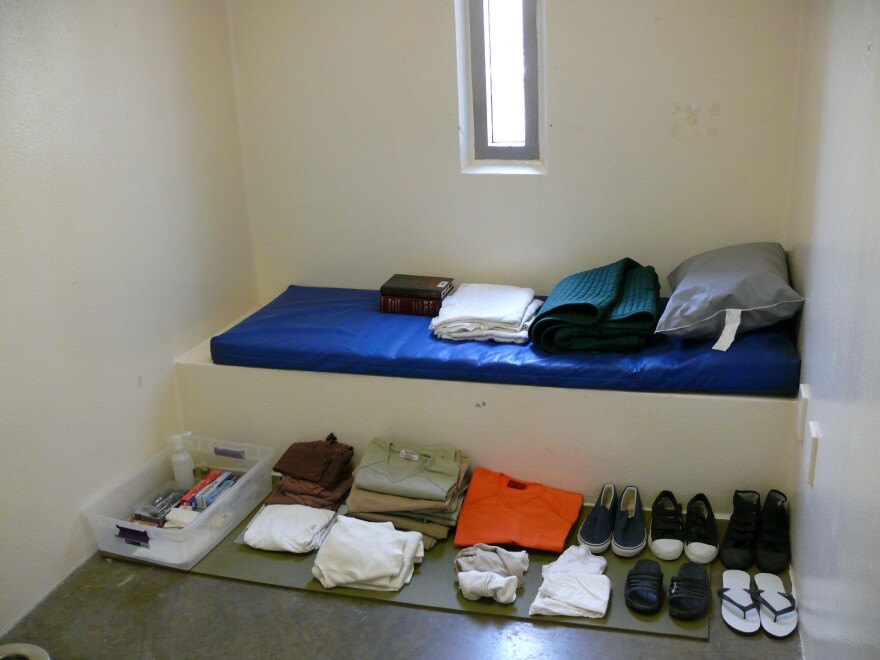 A sample cell, prepared for a media tour. The items displayed are intended to represent the typical belongings a detainee is allowed to keep.