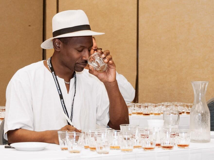 Ian Burrell, a rum ambassador from the U.K., samples the liquor at the Miami Rum Festival.
