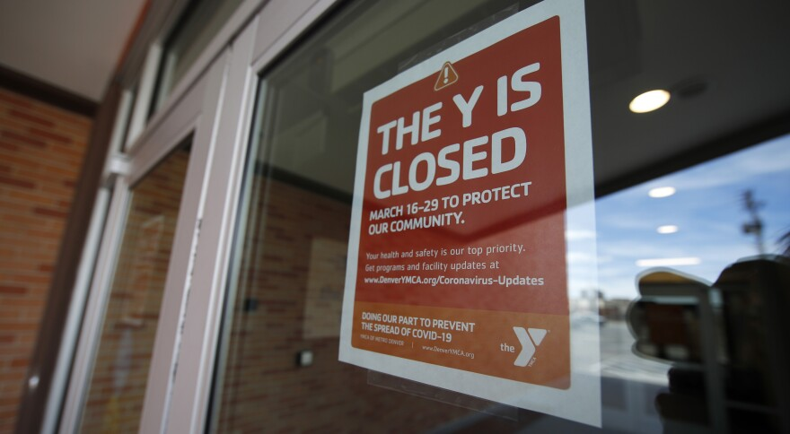 The YMCA is among several national groups asking Congress for $60 billion in emergency funding to nonprofit organizations nationwide. Above, a sign hangs on the door of the  Schlessmann YMCA in Denver, Colo., on March 16, 2020.