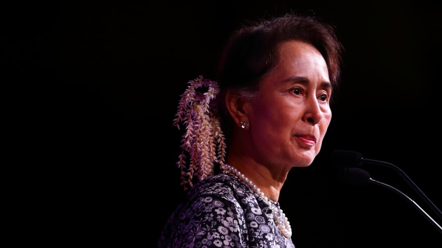 "Aung San Suu Kyi speaks during the 33rd Association of Southeast Asian Nations summit on Monday in Singapore. Amnesty International says it has withdrawn the Ambassador of Conscience Award given to Suu Kyi ""in light of the Myanmar leader's shameful betrayal of the values she once stood for."""