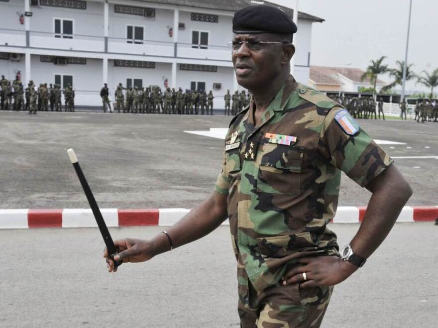 Gen. Philippe Mangou participates in a military ceremony in Abidjan in November 2010.