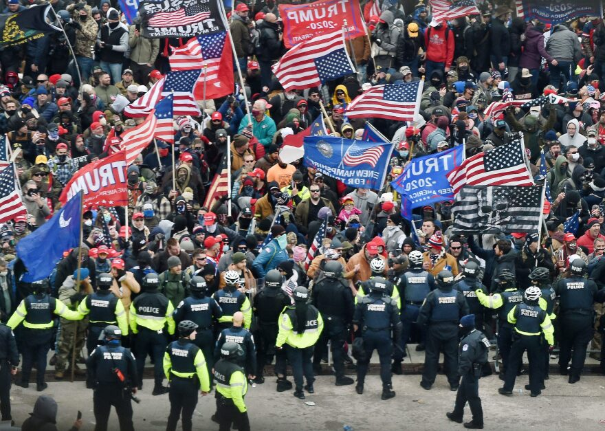 Trump supporters clash with police and security forces as they storm the US Capitol in Washington, DC on Jan. 6, 2021. (Olivier Douliery/AFP via Getty Images)