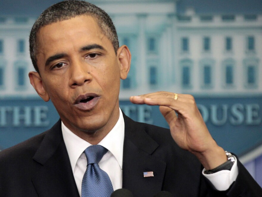 President Barack Obama talks about the ongoing budget negotiations, Monday in the briefing room of the White House in Washington.