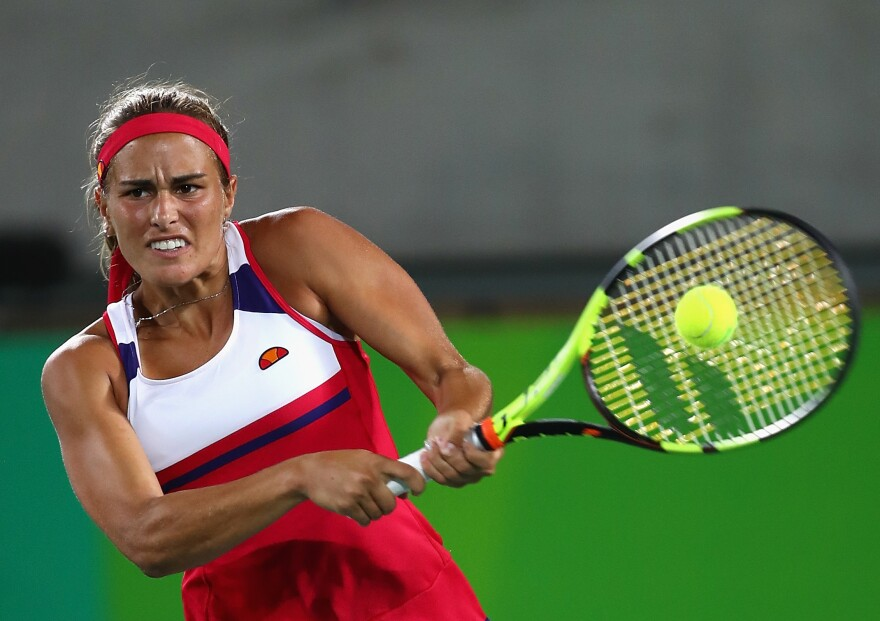 Monica Puig won Puerto Rico's first gold medal, ending a drought that began in 1948. Here, she returns a shot against Angelique Kerber of Germany during their women's singles gold medal match in Rio de Janeiro Saturday.