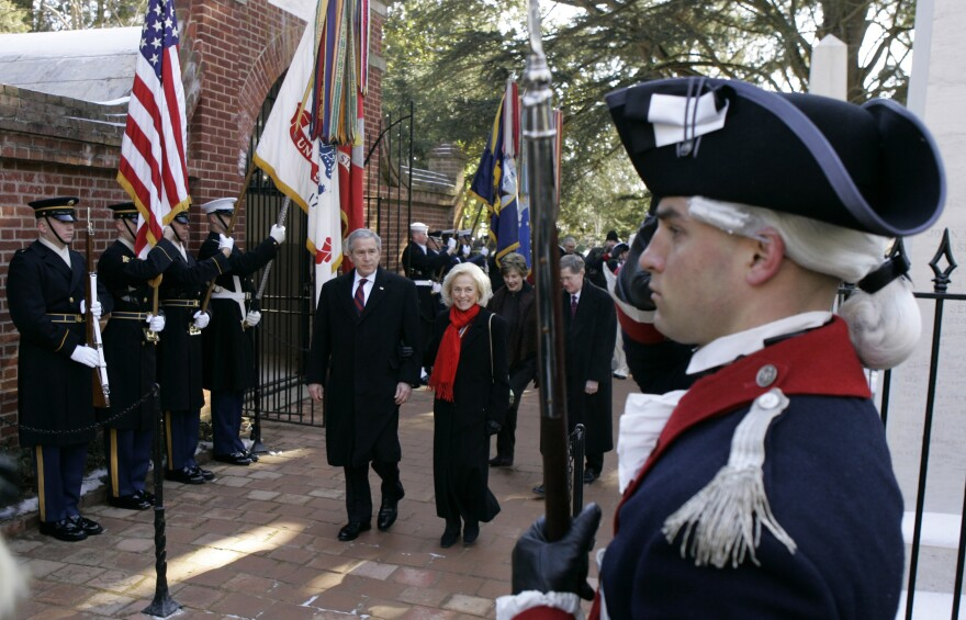 President George W. Bush laid a wreath at George Washington's tomb in Mount Vernon, Va., on the 275th anniversary of his birth, Feb. 19, 2007. Bush is accompanied by Gay Hart Gaines of the Mount Vernon Ladies' Association. Washington set a tradition for early presidents with a modest funeral on his family property. Today's presidential funerals are national events planned by a military task force.