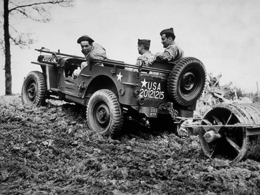 American troops use a Jeep in 1943 to clear land for Army camps in England.