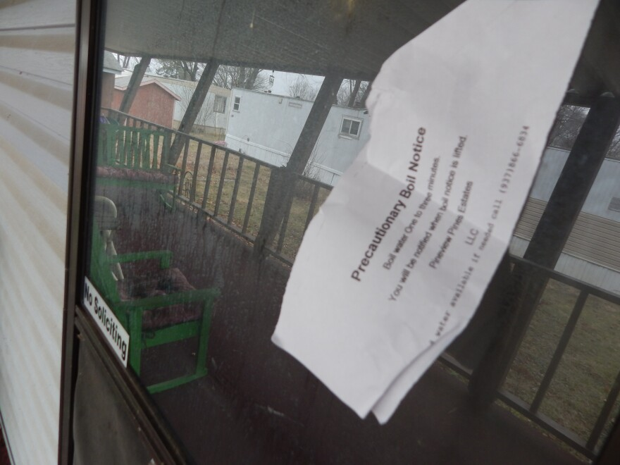 Notices about boil alerts taped to Jeri Reynolds' trailer door often stay there for days—she's unwell, and doesn't venture out much. She says waking up to no water coming out of the tap is routine, but extremely frustrating.