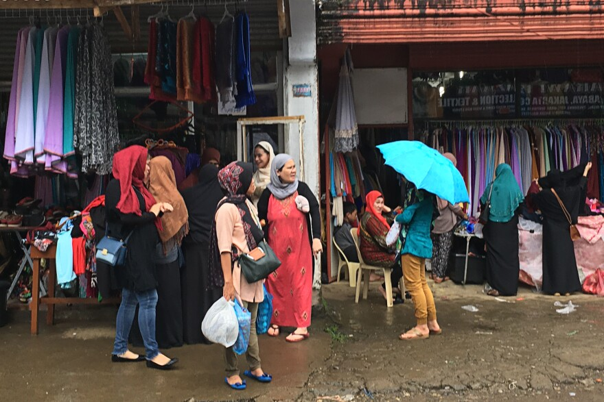 Women shop for clothes in Marawi. Despite martial law, everyday life in parts of the city has started to pick up, more than 19 months after the militants' siege ended in October 2017. A square mile of the city most affected by the fighting remains closed to civilians.