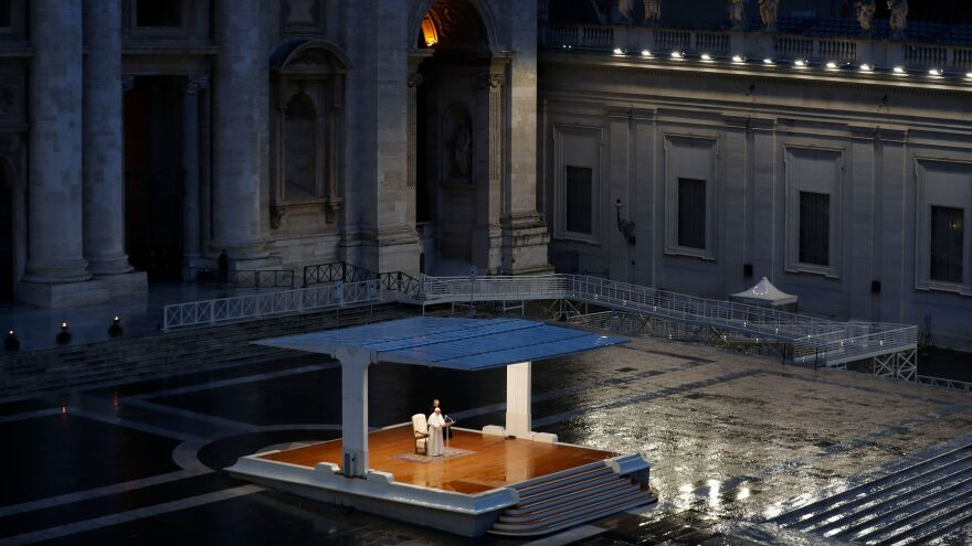 "Pope Francis delivers the Urbi and Orbi (""To the City and To the World"") prayer in an empty St. Peter's Square Friday evening."