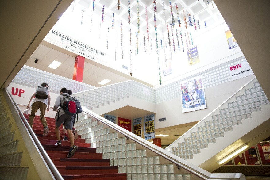 Austin ISD students walk up the stairs of Kealing Middle School.