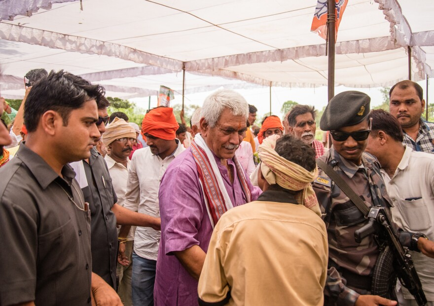 Manoj Sinha, a BJP Cabinet minister, works the crowd at a campaign rally in his constituency in Ghazipur.