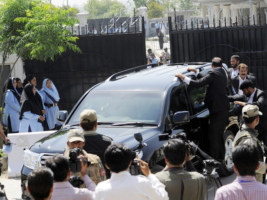 Musharraf's bulletproof SUV leaves the courtroom Thursday immediately after bail was revoked.