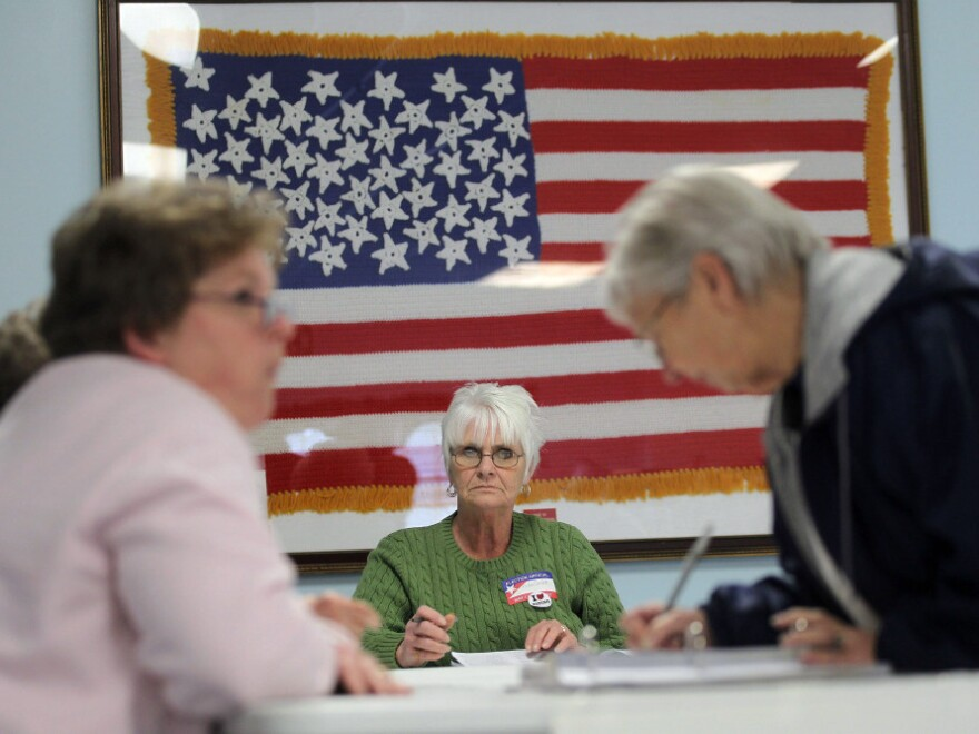 Poll workers assist voters in Carrollton, Ohio, on Tuesday. In the 2010 midterm election, Republicans did better overall among women than Democrats, the GOP's best result among women in 18 years.