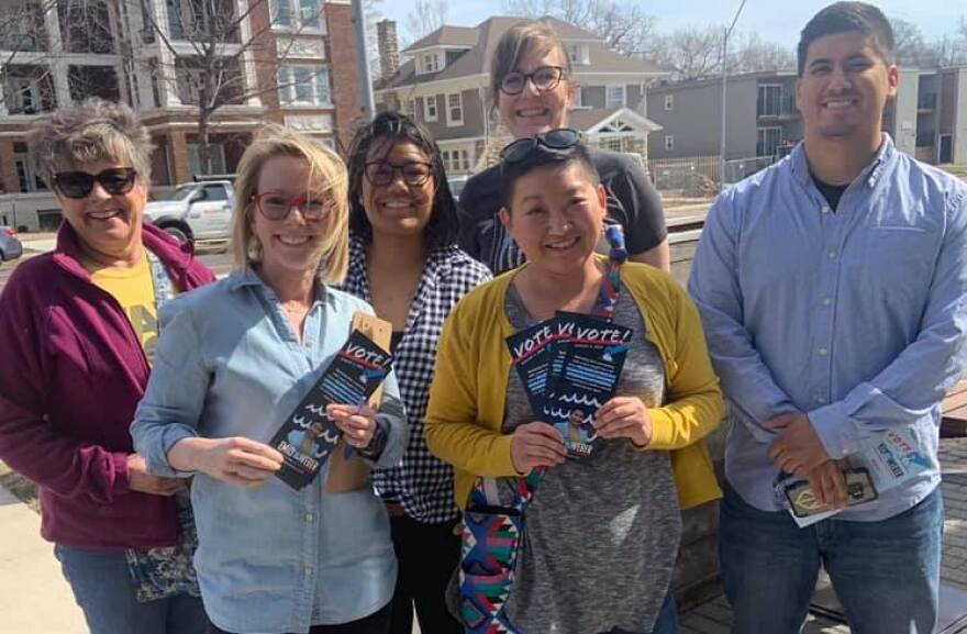 Emily Weber standing with her campaign manager and other volunteers