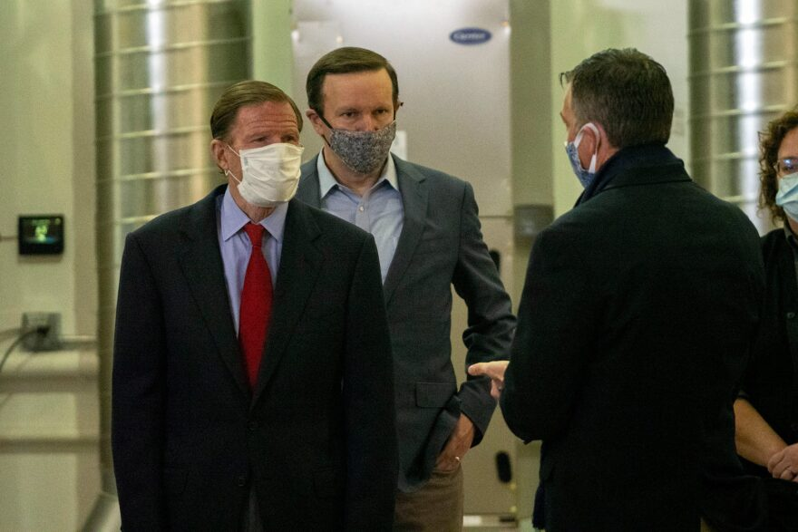 "Sen. Chris Murphy and Sen. Richard Blumenthal tour a PPE decontamination system just set up in a New Haven DOT warehouse. They recently introduced a bill to regulate sales of ""ghost"" gun plans and kits."