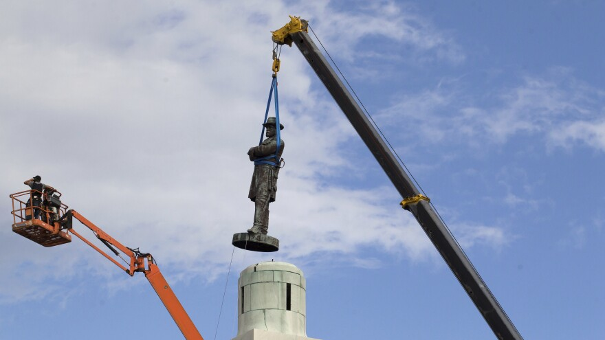 A statue of Gen. Robert E. Lee, as it was removed from its longtime resting place in New Orleans on Friday. Lee's statue was the last of four Confederate monuments to be removed under a 2015 City Council vote.