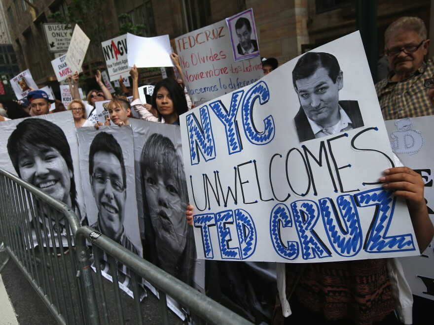 Advocates of overhauling the nation's immigration laws demonstrate outside a fundraising event featuring Texas Sen. Ted Cruz at the Grand Hyatt hotel in New York on Wednesday.