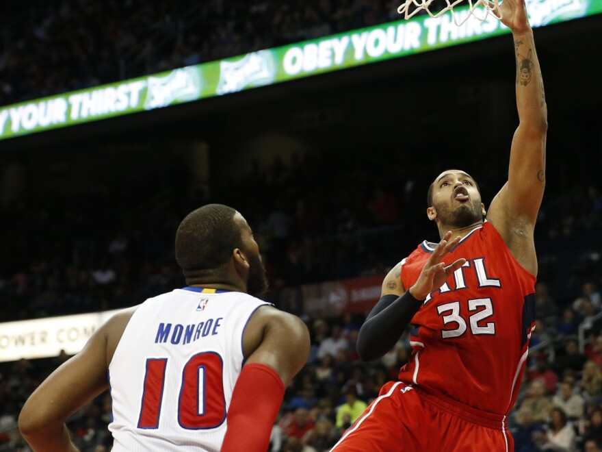 The Atlanta Hawks' Mike Scott scores over the Detroit Pistons' Greg Monroe in a game Monday. The Hawks are currently leading the NBA's Eastern Conference.