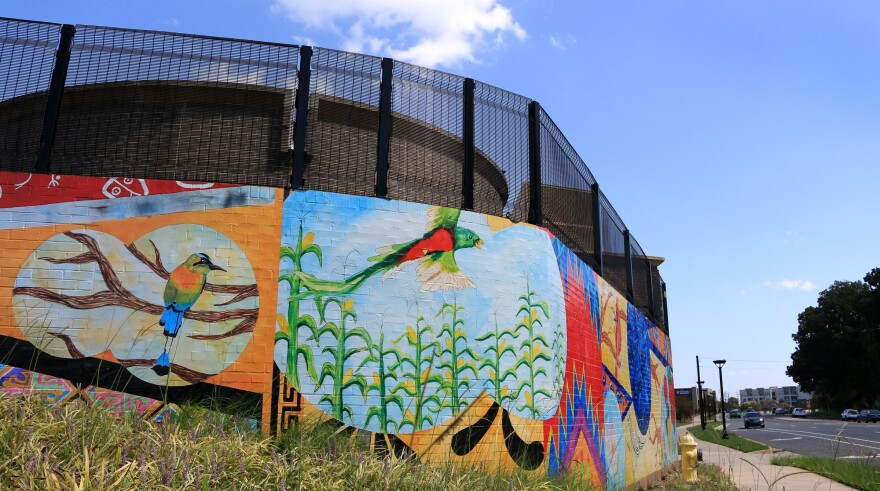"MoRA's ""Tapestry"" mural, seen Sept. 3, 2020, greets drivers at the Charlotte Water site at the intersection of Monroe and Idlewild roads."