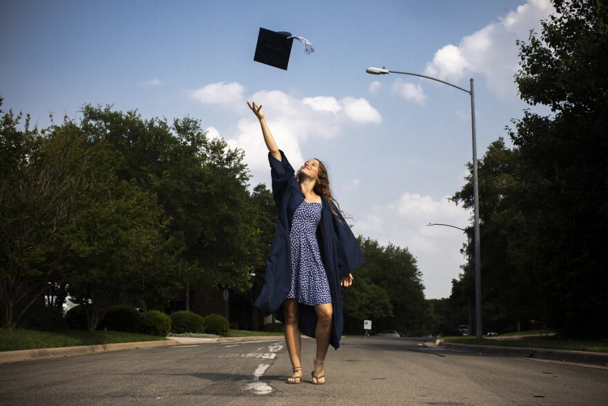 Ashlene Etkie, a senior at the Texas School for the Deaf, throws her graduation cap up in the air.