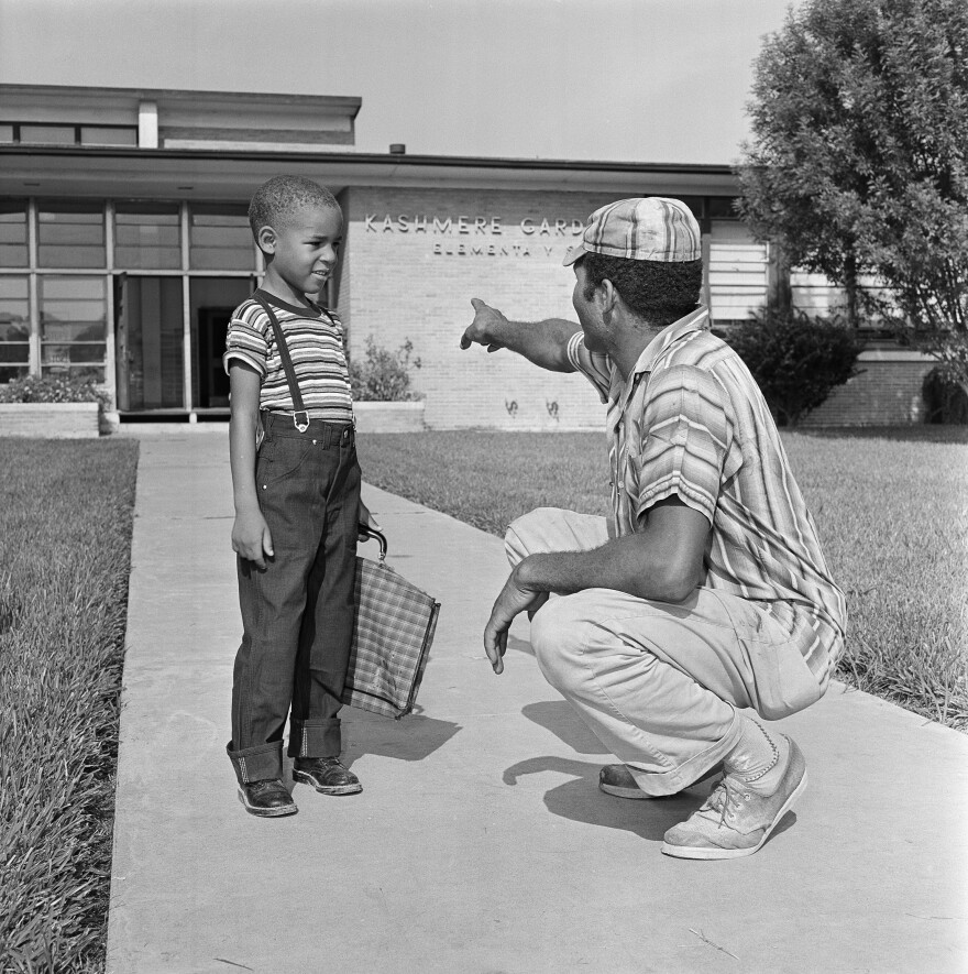 "James E. Smith and his son James Jr., 6, stand in front of Kashmere Gardens Elementary School in Houston on Sept. 7, 1960. The Texas Tribune explored the legacy of desegregation and its continuing impact in a series of stories called ""Dis-Integration."""