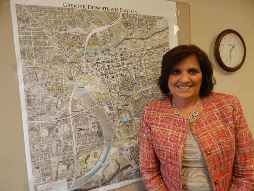 Sandy Gudorf, President of the Downtown Dayton Partnership, with a map of downtown Dayton.