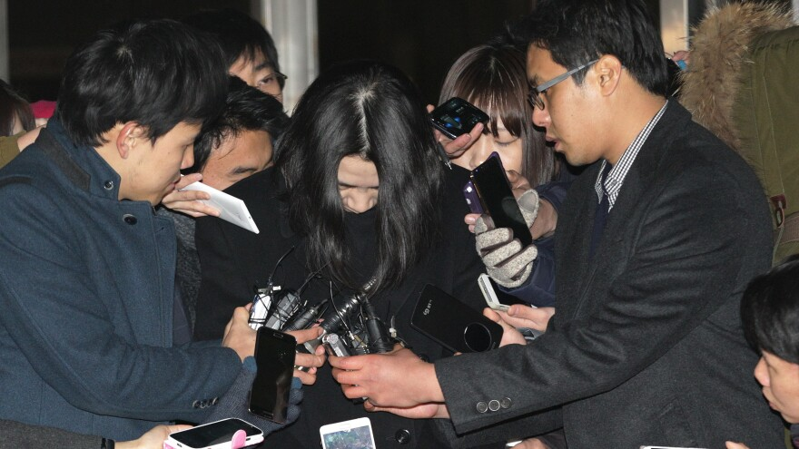 Cho Hyun-ah, center, a former vice president of Korean Air, faces charges of impeding the inquiry into a possible breach of aviation safety laws. She was arrested last Tuesday.