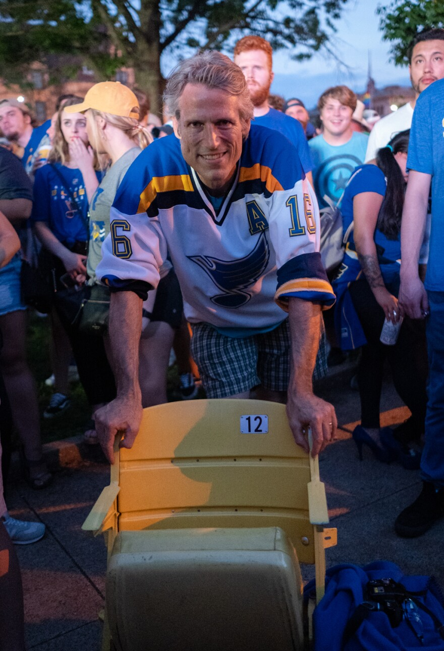 Duane Davison, 54, of Valparaiso, Indiana, brought a seat from the Blues' old home rink, the St. Louis Arena, which was demolished in 1999, to the Game 6 watch party downtown