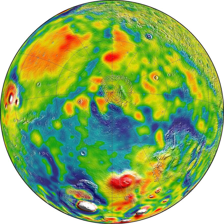 A map of Martian gravity looking down on the North Pole (center). White and red are areas of higher gravity; blue indicates areas of lower gravity.