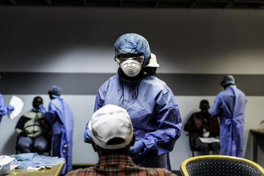 A medical worker tests Haitians for coronavirus in Port-au-Prince.