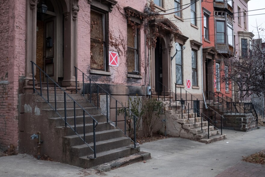 A row of vacant homes are marked as unsafe structures in Arbor Hill. More than a quarter of the buildings in the neighborhood are abandoned.