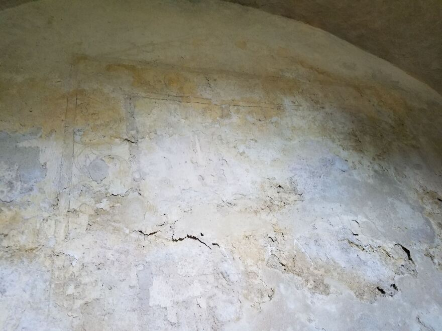 A 266-year-old water-damaged fresco in the Mission Concepción's baptistry can barely be seen in this photo. | credit Norma Martinez / Texas Public Radio