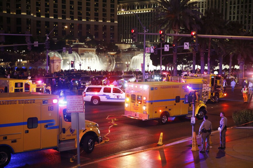 Police and emergency crews respond to the scene of a car incident along Las Vegas Boulevard on Sunday.