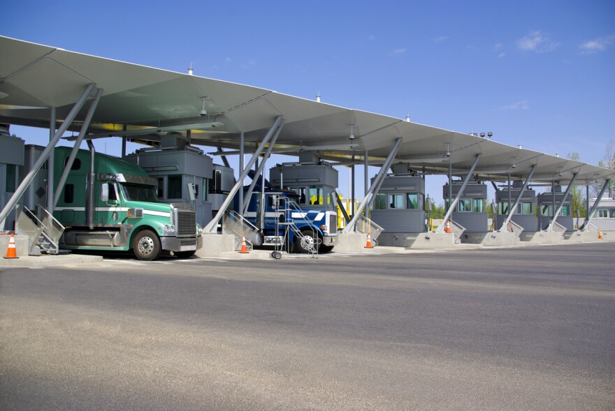 Trucks wait at a Canadian border crossing.