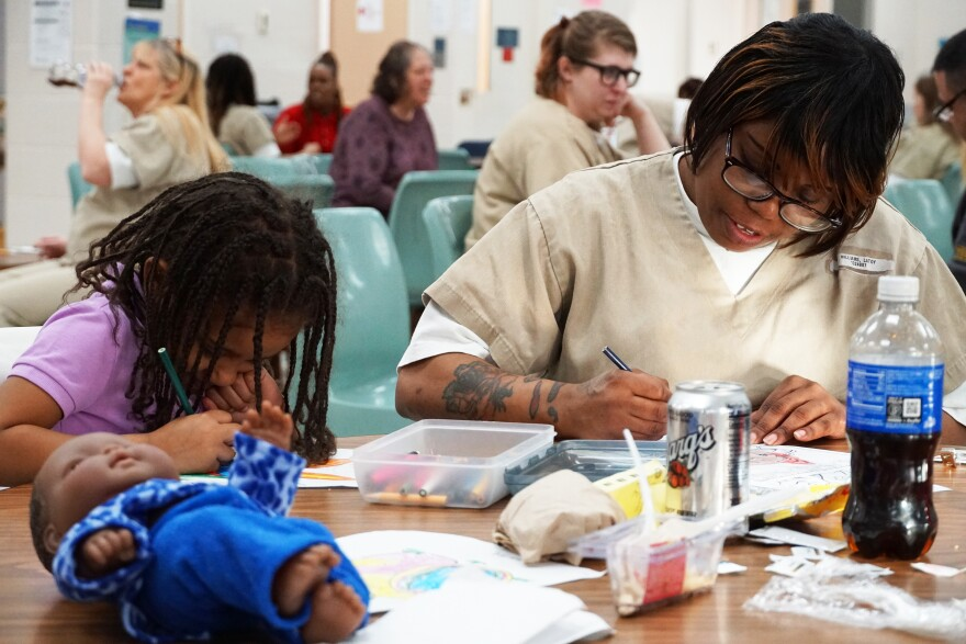 Latoy Williams, right, spends time with her family at the state prison in Vandalia on February 23, 2020. In mid-March, the Missouri Department of Corrections suspended all visitation due to the pandemic.