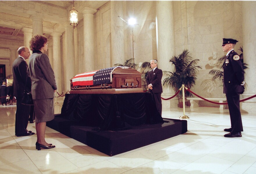 Former law clerks of retired Supreme Court Justice Harry Blackmun stand vigil near the casket of Blackmun as his body lies in repose atop the Lincoln Catafalque in the Great Hall of the court in March 1999.