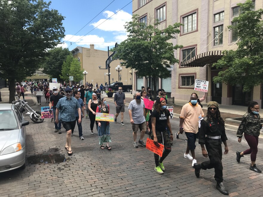 Residents march through the Oregon District on May 30 protesting the killing of George Floyd.