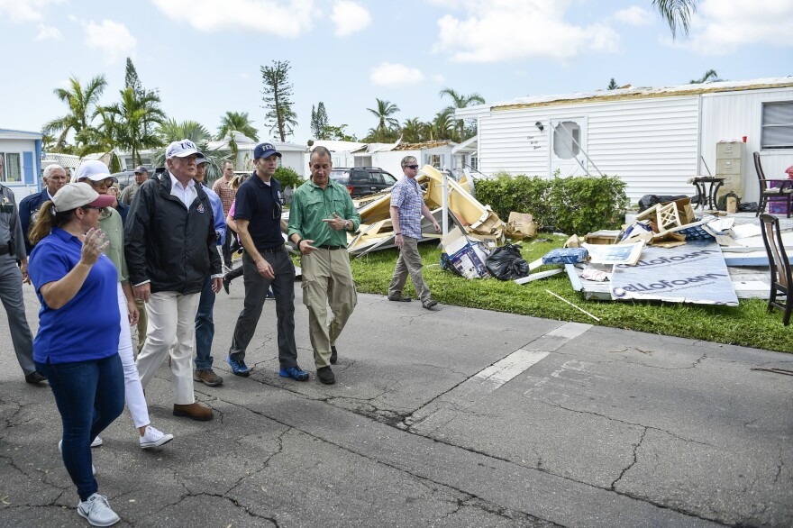 President Trump tours a neighborhood on Thursday in Naples, Fla., affected by Hurricane Irma.