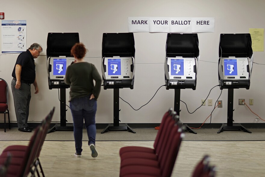 Electronic voting machines being tested in Conyers, Ga. The state has been the focal point for the debate over how closely election officials and the voting industry are intertwined.