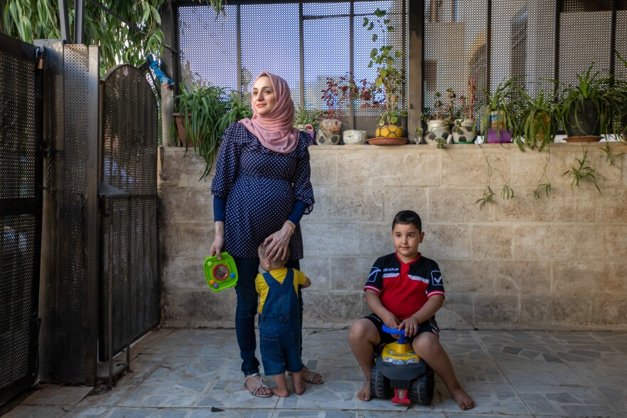 Sawsan al-Ramemi with sons Zain, left, and Omer at home in Amman. She is expecting her third child.