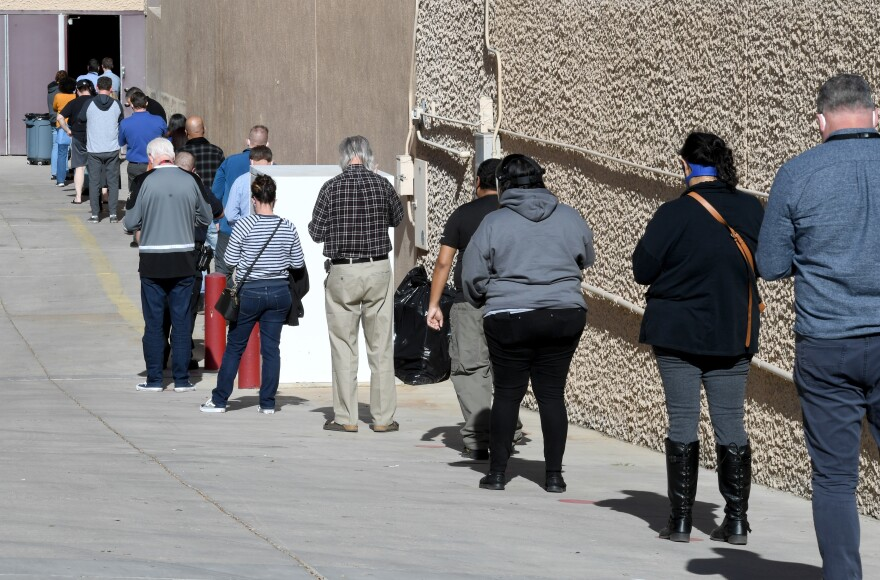 People line up on Thursday for the first day of Clark County's pilot COVID-19 vaccination program at Cashman Center in Las Vegas.