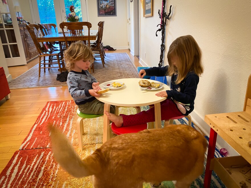 Abby Bucolo, right, eats breakfast with her brother Henry at a bed-and-breakfast their parents are renting after their home was destroyed by the Almeda Fire.