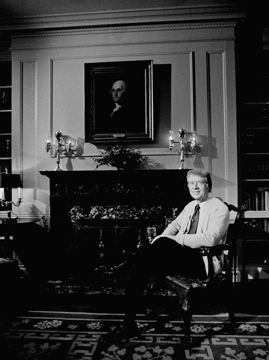 "President Carter sits in the library of the White House living quarters in 1977, just prior to airtime for a nationally televised ""fireside chat."""